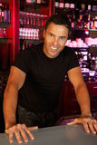 Portrait Of Barman Standing Behind Bar Royalty Free Stock Photos