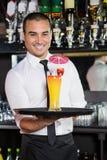 Portrait of bartender serving cocktail Stock Photography