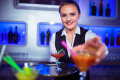 Portrait of bartender serving cocktail Stock Photo