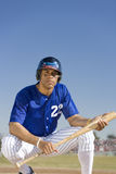Portrait of baseball player holding bat Royalty Free Stock Photography