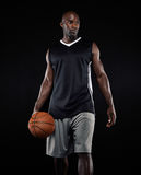 Portrait of basketball player on black background Stock Photo