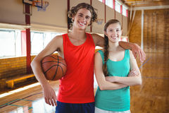 Portrait of basketball players standing with arm around Stock Image