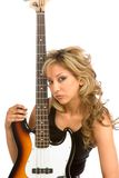 Portrait with bass. Portrait of Girl with electric bass guitar royalty free stock photos