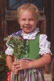 Portrait of a Bavarian flower girl Stock Image