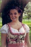 Portrait of a Bavarian girl in dirndl. Portrait of a young Bavarian girl in dirndl and braid hairstyle stock photo