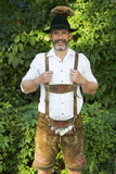 Portrait of bavarian man in lederhosen royalty free stock photo
