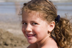 Portrait at the beach. Close up of a little girl on the beach Stock Photos