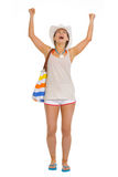 Portrait of beach young woman rejoicing success Stock Photo