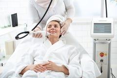 Glad woman having professional rejuvenation stock photo