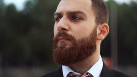 Portrait of beard businessman outdoors stock footage