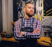 Portrait of bearded bicycle mechanic with crossed arms. stock photos