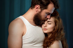 Portrait of a bearded, brutal guy and beautiful girl Stock Image