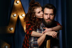 Portrait of a bearded, brutal guy and beautiful girl Royalty Free Stock Photos