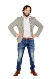 Portrait of bearded business man posing with his arms akimbo royalty free stock image