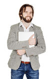 Portrait of bearded business man standing with laptop and looking at camera royalty free stock images