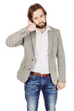 Portrait of bearded businessman standing and making call me gest Royalty Free Stock Photos