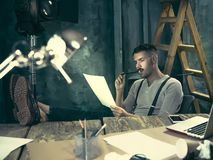Portrait of a bearded businessman who is working with his notebook at loft studio. Stock Photography