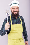 Portrait of a bearded chef holding a big spoon Royalty Free Stock Images