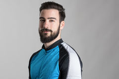 Portrait of bearded cyclist wearing jersey with copyspace looking at camera Stock Images