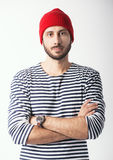 Portrait of bearded guy in sailor striped shirt Stock Photos