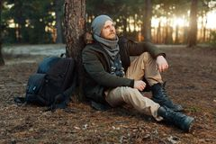 Portrait of a bearded hipster tourist man in the woods forest. Portrait of a bearded hipster tourist man in the woodsbearded hipster tourist man in the woods Royalty Free Stock Photos