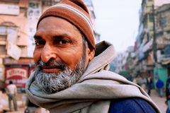 Portrait of an bearded Indian passer on the crowded indian street Royalty Free Stock Photography