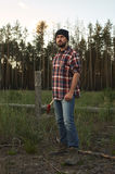 Portrait of bearded Lumberjack with Hat, Boots, Shirt and Ax Royalty Free Stock Image