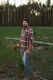 Portrait of bearded Lumberjack with Hat, Shirt and Ax Stock Photo