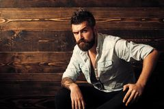 Portrait of bearded male in jeans shirt with tattoo on his hand, copy space.  Royalty Free Stock Photos