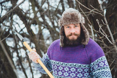 Portrait of a Bearded Man with an ax in his hand. Brutal bearded man with an ax. North bearded man with an ax in the woods Stock Photography