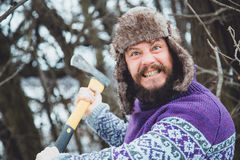 Portrait of a Bearded Man with an ax in his hand. Brutal bearded man with an ax. North bearded man with an ax in the woods Stock Images
