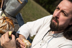 Portrait of a bearded man with cheese and bread Royalty Free Stock Photo