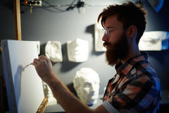 Portrait of Bearded Man Drawing on Canvas Royalty Free Stock Image