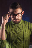 Portrait of a bearded man with glasses,. A mustachioed guy in a green sweater Stock Image