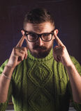 Portrait of a bearded man with glasses,. A mustachioed guy in a green sweater Royalty Free Stock Photography