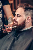 Portrait of a bearded man hipster in a Barbershop stock images