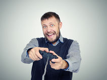 Portrait bearded man with a joystick playing in game. Gamer concept Royalty Free Stock Photo