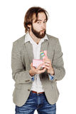 Portrait of bearded man opening a surprise gift in a pink box wi Royalty Free Stock Image