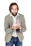 Portrait of bearded man opening a surprise gift in a pink box wi Royalty Free Stock Photography