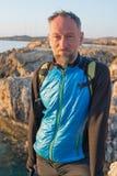 Portrait of bearded man on sea coast. Stock Images