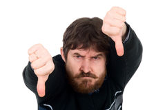 Portrait of the bearded man showing thumbs down. Stock Photos