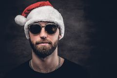 A man in Santa`s hat. Portrait of bearded man wearing Santa`s hat stock photos
