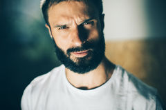 Portrait of a bearded man wearing white tshirt Stock Images