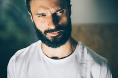 Portrait of a bearded man wearing white tshirt on Stock Photo