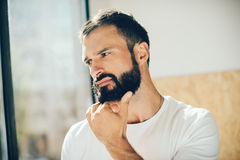 Portrait of a bearded man wearing white tshirt and Royalty Free Stock Images