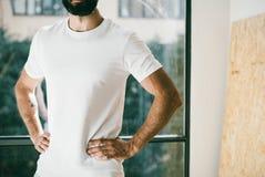 Portrait of a bearded man wearing white tshirt Stock Photo