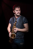 Portrait of a bearded saxophonist Royalty Free Stock Photo