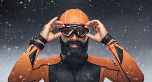 Bearded scuba diver under rain drops. Portrait of bearded scuba diver under rain drops over snow mountains background Royalty Free Stock Photos