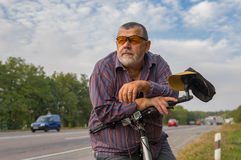 Portrait of a bearded senior man with bicycle Royalty Free Stock Photography