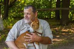 Portrait of a bearded senior man with his basenji dog Royalty Free Stock Images